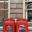 Traditional London telephone boxes - Stock Photo