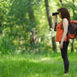 Woman observing wildlife — Stock Photo