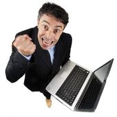 Furious businessman shaking his fist — Stock Photo