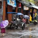 Little girl in the rain on a Philippines street — Stock Photo