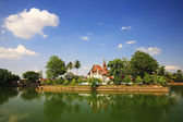 Temple with reflection on lake in Sukhothai — Stock Photo