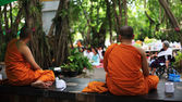 Thai monks wait people to offer foods — Stok fotoğraf