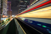 Motion of BTS sky train at night in Bangkok — Stock Photo