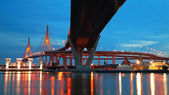 Bhumibol Suspension Bridge across Chao Phraya river at twilight — Stock Photo