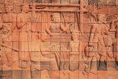 тайский традиционный древней культуры по камню на стене храма — Стоковое фото