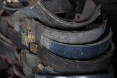 Used rusty metallic car parts in garage — Stock Photo