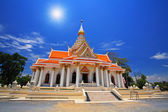 Thai temple against sunbeam and blue sky — Stock Photo