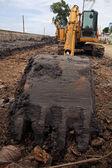 Scoop shovel of yellow excavator machine diging dirt — Stock Photo