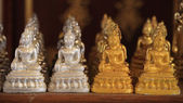 Many gold and silver small Buddha statues — Stock Photo