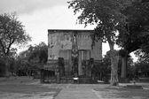 Ancient Buddha statue inside church or mondop — Stock Photo
