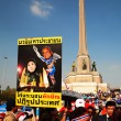 Stock Photo: Banner of Yingluck and Thaksin defeated by Suthep