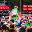 Stock Photo: Thai protesters raise anti Shinawatrbanner