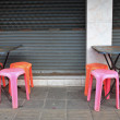 Stock Photo: Old tables and plastic chairs