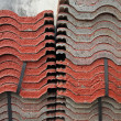 Stock Photo: Stack of red tiles for construction