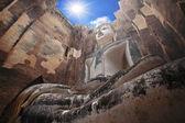 Buddha statue against sunbeam at Sukhothai — Stock Photo