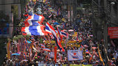 Thai protestors rally with large thai flag — Stock Photo