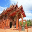 Red Thai temple against blue sky in Ubon — Stok fotoğraf