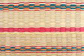 Textured pattern of weaving colorfu mat  — Stock Photo