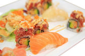 Salmon sushi and spicy tuna rolls on plate isolated — Stock Photo