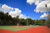 Outdoor tennis courts against blue sky — Stock Photo