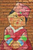 Painted Brick wall of Korean girl  — Stock Photo