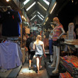 Foreign girl shopping at Chatuchak weekend market in Bangkok — Stock Photo #49699049