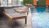 Swimming pool with relax chairs — Foto Stock