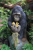 Gorilla statue carrying banana — Stock Photo