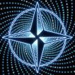 图库照片: Disco compass symbol with bleu light effects