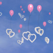 Happy two hearts symbols on flying balloons — Stock Photo #21855243