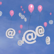 Flying e-mail balloons in the sky — Stock Photo