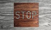 Wooden Sustainable stop symbol in a stylish background — Stock Photo