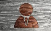 Ecological business man symbol in a wooden background — Stock Photo