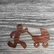 Isolated baby buggy symbol in wooden background — Stock Photo #22679065