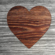 Sustainable heart symbol  in a wooden background — Stock Photo