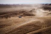 Terrain vehicle crossing the Sahara desert — Stock Photo