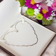 Valentines day gift - White gold necklace in a shape of heart — Stock Photo #17429979