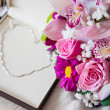 Valentines day gift - Gold necklace in a heart position and a flowers — Stock Photo #17431039