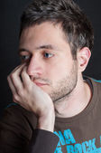 Young man that looks worried about something — Stock Photo