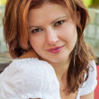 Beutiful redhead girl portrait in a white t-shirt — Stock Photo #35189927