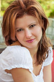 Beutiful redhead girl portrait in a white t-shirt — Stock Photo