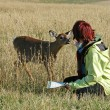 Deer petting — Stock Photo