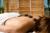 Stone massage — Stock Photo