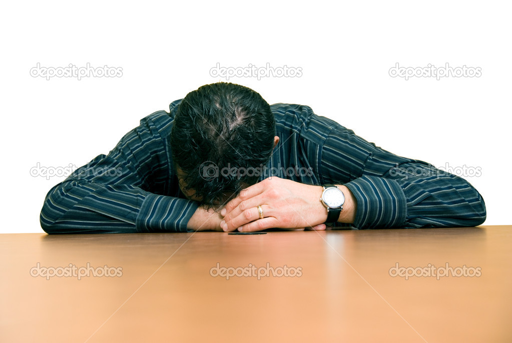 Business man sleeping at his desk in the office  Stock Photo #12198744