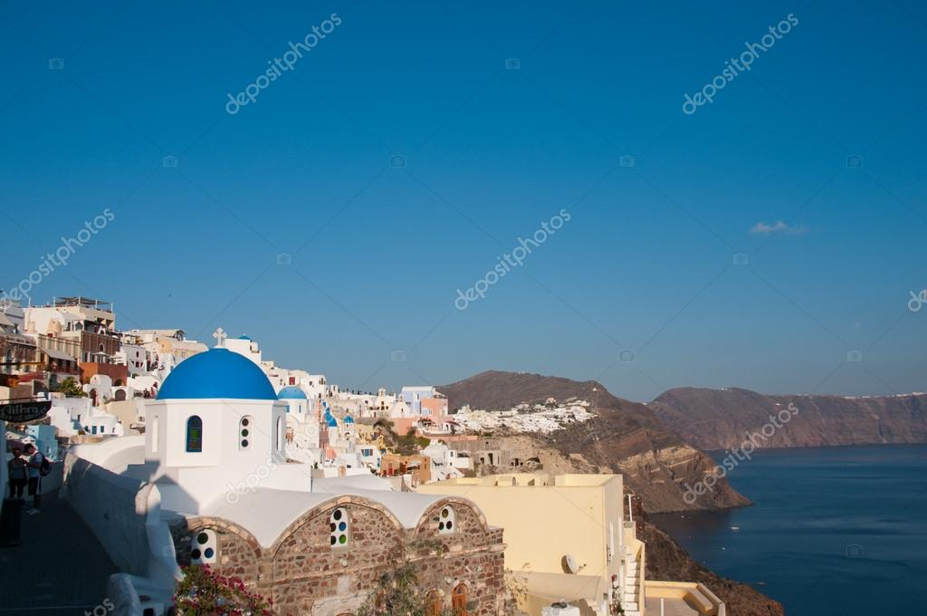Greek church in santorini greece with a cross — Stock Photo #12198915