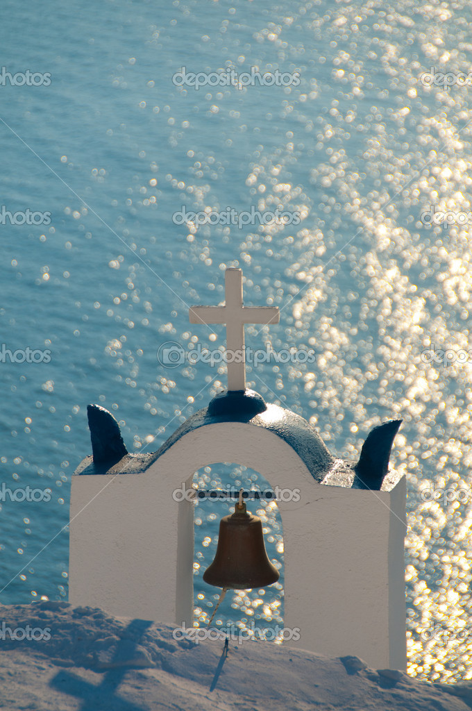 Greek church in santorini greece with a cross — Stock Photo #12198920