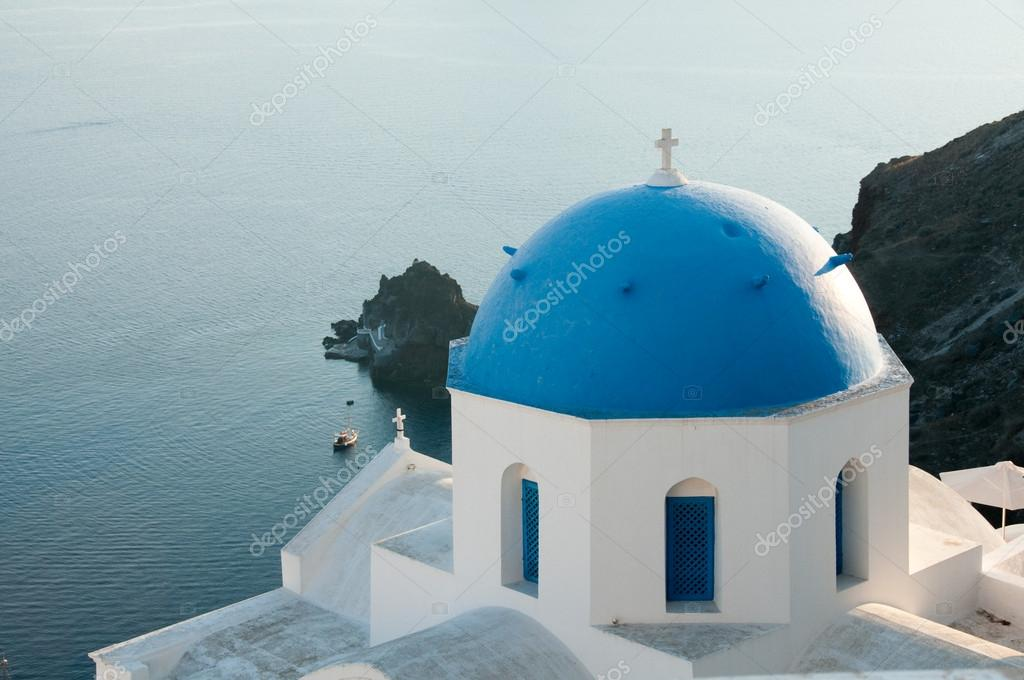 Greek church in santorini greece with a cross — Stock Photo #12198967