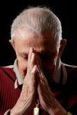 Grandfather in prayer — Stock Photo