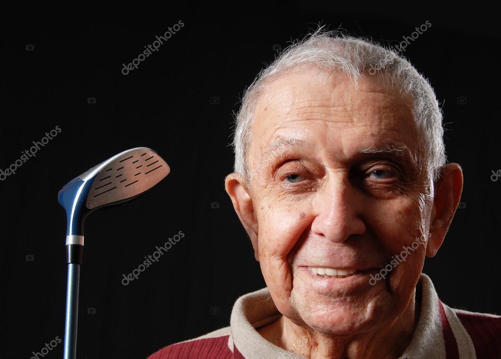 abuelo feliz con su club oro sonriendo — Foto de yanc - depositphotos_12363800-Golf-elderly
