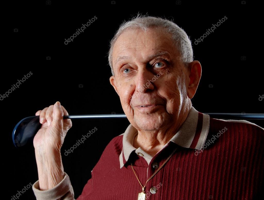 abuelo feliz con su club oro sonriendo — Foto de yanc - depositphotos_12363802-Golfing-gandpa